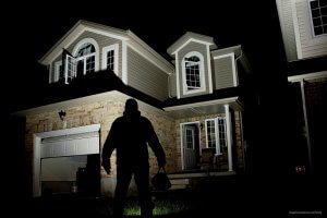 burglar facing home burglar alarm